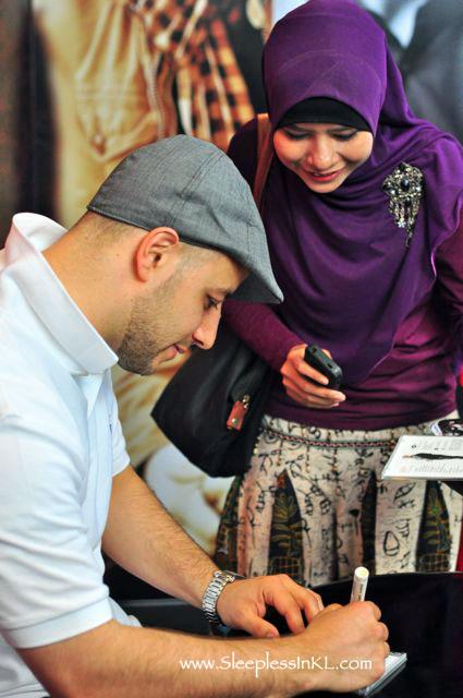 Maher Zain signing autographs
